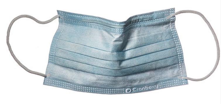 Una imagen que muestra un cubrebocas médico azul.